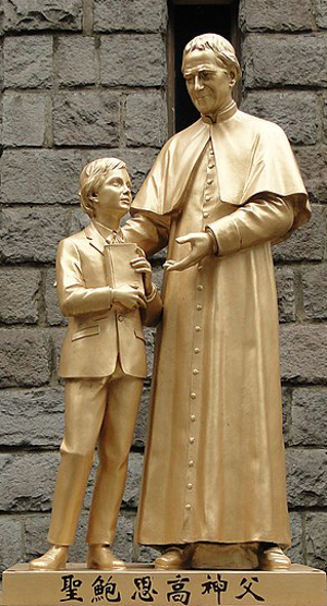 Photo of statue of John Bosco and a child, from the church of St. John Bosco, Taipei, Taiwan